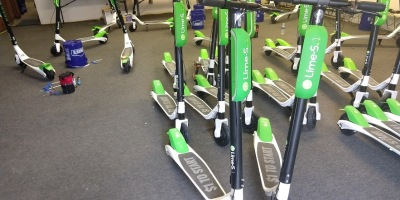 Lime scooters charge and stand ready at Lime's 44th street Indianapolis HQ